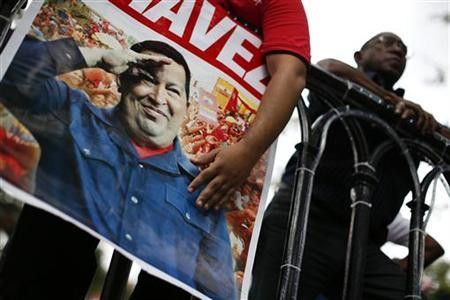 Followers of Venezuelan President Hugo Chavez gather to express their support to him and pray for his health at Plaza Bolivar in Caracas December 9, 2012. REUTERS/Jorge Silva