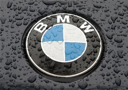 The logo of German car manufacturer BMW is seen on the bonnet of a vehicle covered with water drops in Kiev March 27, 2012. REUTERS/Str (UKRAINE - Tags: TRANSPORT BUSINESS LOGO)