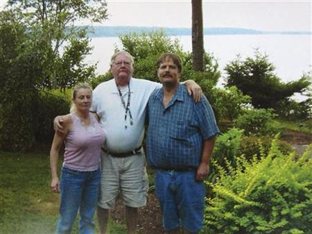Colleen LaRose (L), a Pennsylvania woman who named herself 'Jihad Jane,' stands next to her boyfriend Kurt Gorman (R) and his father David Gorman (C) in an undated family photo believed to have been taken sometime between 2005 and 2009 and supplied by her family. REUTERS/Family Photo/Handout