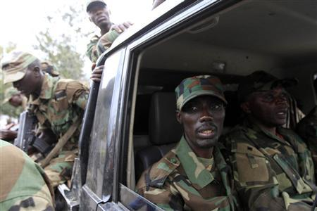 Congolese Revolution Army (CRA) rebel leader Sultani Makenga sits in a truck in Goma in the eastern Democratic Republic of Congo (DRC), November 20, 2012, soon after the rebels captured the city from the government army. REUTERS/James Akena/Files