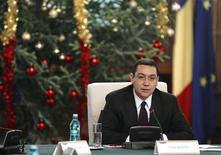 Romania's Prime Minister Victor Ponta heads a government meeting at Victoria palace in Bucharest December 10, 2012. REUTERS/Bogdan Cristel