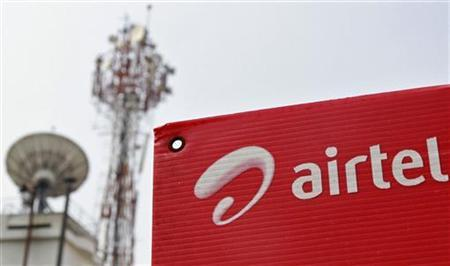 A Bharti Airtel advertisement board is installed against the backdrop of company's telecommunication tower in Kochi November 30, 2012. REUTERS/Sivaram V