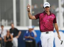 Rory McIlroy of Northern Ireland gestures at the 18th green during the third round of the DP World Tour Championship at Jumeirah Golf Estates in Dubai November 24, 2012. REUTERS/Jumana El Heloueh