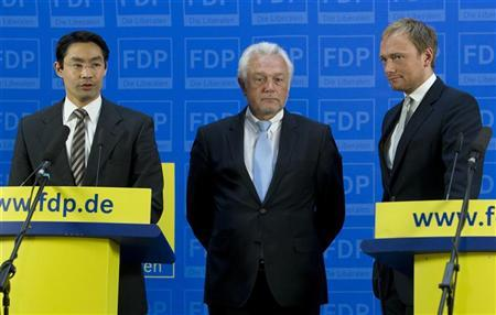 The leader of the liberal Free Democratic Party (FDP), Economy Minister Philipp Roesler (L), and party colleagues Christian Lindner (R) and Wolfgang Kubicki attend a news conference about the election successes in their respective states North-Rhine Westphalia (NRW) and Schleswig-Holstein at the FDP headquarters in Berlin, May 14, 2012. REUTERS/Thomas Peter