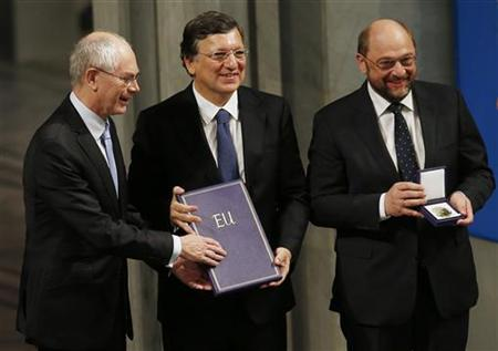 European Union (EU) representatives, President of the European Council Herman Van Rompuy (L), President of the European Commission Jose Manuel Barroso (C) and President of the European Parliament Martin Schulz hold the Nobel Peace Prize after they accepted it on behalf of the EU during a ceremony at City Hall in Oslo December 10, 2012. The European Union received the Nobel Peace Prize on Monday, honoured by the Norwegian committee which looked beyond Europe's current malaise to recognise its decades of stability and democracy after the horrors of two world wars. REUTERS/Suzanne Plunkett (NORWAY - Tags: POLITICS BUSINESS)