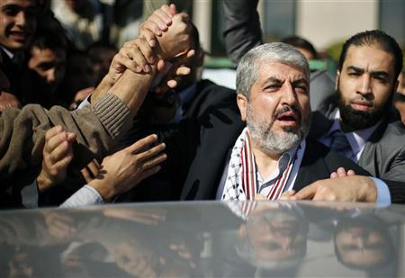 Palestinian students hold the hand of Hamas chief Khaled Meshaal (2nd R) during his visit to the Islamic University in Gaza City December 9, 2012. REUTERS/Suhaib Salem