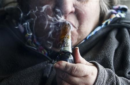 A medical marijuana patient smokes inside of Frankie Sports Bar and Grill in Olympia, Washington December 9, 2012. REUTERS/Nick Adams