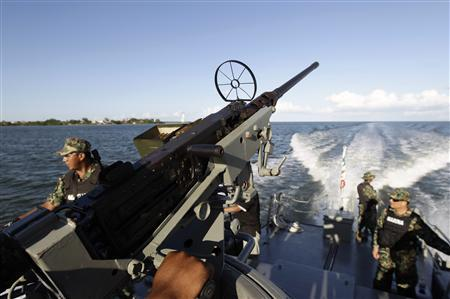 Mexican marines patrol the coastline of Chetumal November 16, 2012. REUTERS/Henry Romero