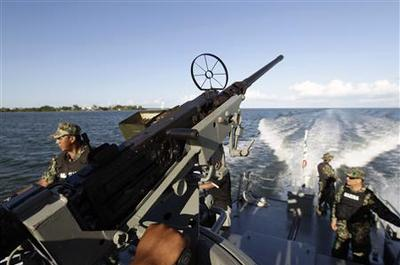 Analysis: Mexican navy to hold the fort during shift...