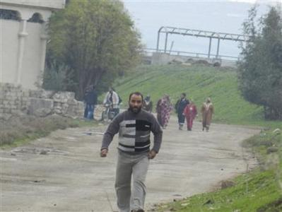 Residents flee their homes after a shelling by forces loyal to Syria's President Bashar al-Assad at Houla, near Homs, December 10, 2012. REUTERS/Misra Al-Misri/Shaam News Network/Handout