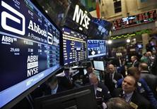 Traders gather at the booth that trades Abbott Laboratories on the floor of the New York Stock Exchange, December 10, 2012. REUTERS/Brendan McDermid (UNITED STATES - Tags: BUSINESS)