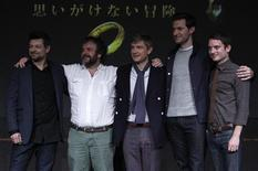 "New Zealand director Peter Jackson (2nd L) and cast members Andy Serkis (L), Martin Freeman (3rd L), Richard Armitage (2nd R) and Elijah Wood pose on a stage at a news conference promoting their movie ""The Hobbit - An Unexpected Journey"" in Tokyo December 1, 2012. REUTERS/Issei Kato"