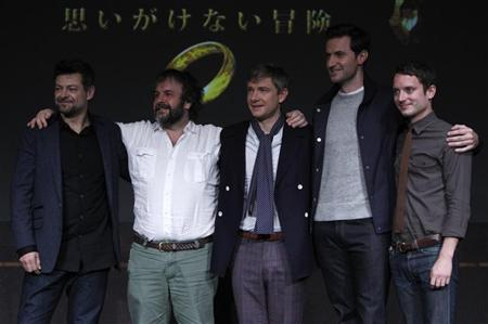 New Zealand director Peter Jackson (2nd L) and cast members Andy Serkis (L), Martin Freeman (3rd L), Richard Armitage (2nd R) and Elijah Wood pose on a stage at a news conference promoting their movie ''The Hobbit - An Unexpected Journey'' in Tokyo December 1, 2012. REUTERS/Issei Kato