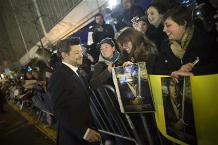 Actor Andy Serkis signs autographs for fans at the premiere of the film The Hobbit in New York December 6, 2012. REUTERS/Andrew Kelly