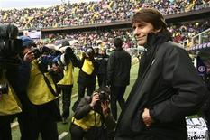 O técnico do Juventus, Antonio Conte, posa para fotografias antes de partida contra o Palermo no estádio Renzo Barbera em Palermo, Itália. 9/12/2012 REUTERS/Massimo Barbanera