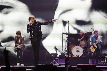 Members of the band The Rolling Stones (L-R) Ronnie Wood, Mick Jagger, Charlie Watts, and Keith Richards perform at the Barclays Center in New York, December 8, 2012. REUTERS/Lucas Jackson