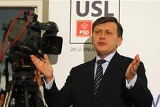 Crin Antonescu, one of Romania's Social Liberal Union (USL) leaders and president of National Liberal Party, gestures after first exit polls for parliamentary elections in Bucharest December 9, 2012. Exit polls showed Romania's prime minister won a clear victory in a Sunday election, which may herald another round of a power struggle with the rightist president and complicate talks for a new IMF deal. Victor Ponta's leftist Social Liberal Union won 54-58 percent of votes according to three exit polls and is headed for a majority, but analysts said President Traian Basescu may ask someone else from the USL to form a government. REUTERS/Bogdan Cristel