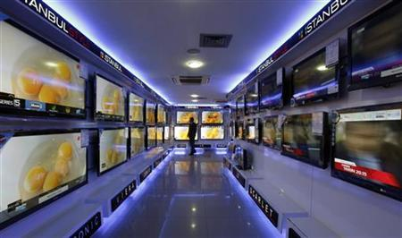 A customer looks at large screen televisions at a shop in Istanbul March 8, 2011. REUTERS/Osman Orsal/Files