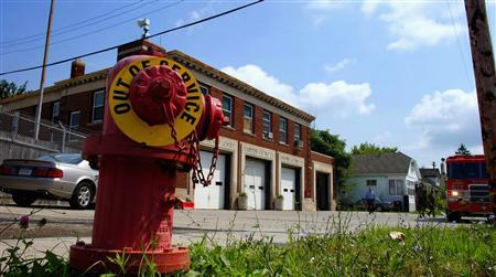 A closed fire hydrant is seen in front of a Detroit fire station in this publicity photo from the documentary film ''Burn'', released to Reuters December 10, 2012. For an entire year, producers Tom Putnam and Brenna Sanchez, a Detroit native now living in Los Angeles, followed the firefighters of Engine Company 50 (E50) on Detroit's downtrodden east side, chronicling their triumphs and tragedies, as well as their private moments. REUTERS/Burn/Handout