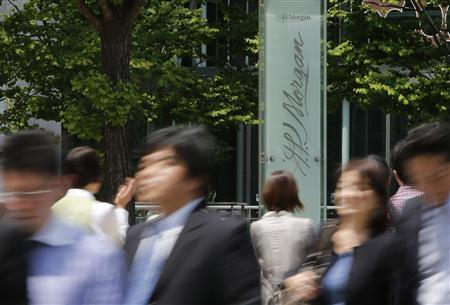 People walk past J.P. Morgan Tokyo Building in Tokyo in this May 11, 2012 file photo. REUTERS/Toru Hanai/Files