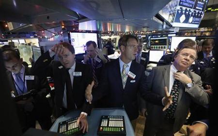 Traders work on the floor of the New York Stock Exchange December 10, 2012. REUTERS/Brendan McDermid