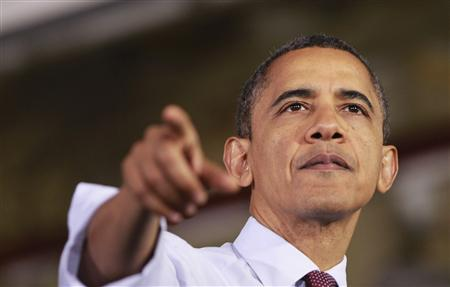 U.S. President Barack Obama gestures as he delivers remarks on the economy to employees at the Daimler Detroit Diesel plant in Redford, Michigan, December 10, 2012. REUTERS/Jason Reed
