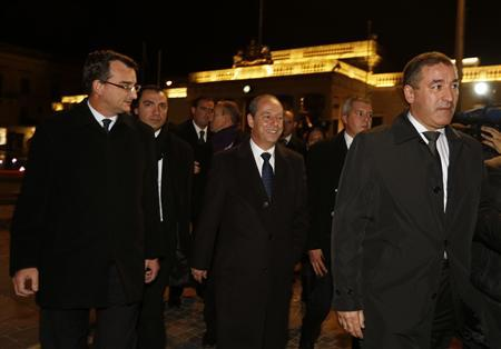 Malta's Prime Minister Lawrence Gonzi (C) leaves parliament after losing a budget vote tied to a vote of confidence in Valletta December 10, 2012. REUTERS/Darrin Zammit Lupi