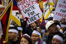Protesters chant and hold placards as they take part in a solidarity march from the Chinese Consulate to the United Nations (UN) Headquarters in support of Tibet in New York, December 10, 2012. REUTERS/Lucas Jackson