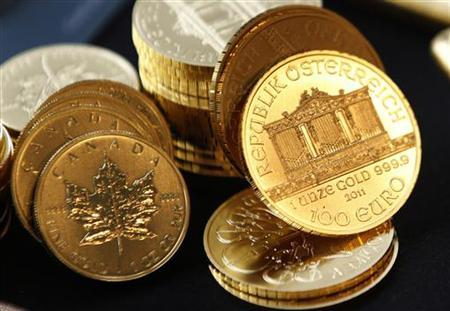 Canadian (L) and Austrian (R) gold coins are seen in New York September 15, 2011. REUTERS/Mike Segar/Files