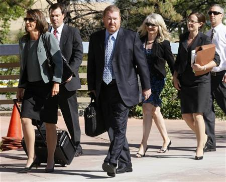 The defense team including public defender Daniel King (C) and Tamara Brady arrive for the second court appearance of James Holmes, in Centennial, Colorado July 30, 2012. REUTERS/Rick Wilking