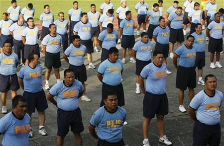 Police officers take part in the Weight Loss Management Program at Camp Crame in Quezon City Metro Manila June 19, 2012. REUTERS/Cheryl Ravelo/Files