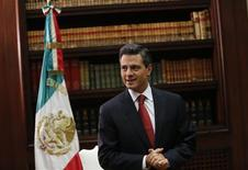 Mexico's President Enrique Pena Nieto speaks with Reuters at the presidential palace in Mexico City December 10, 2012. Pena Nieto said on Monday he is confident that energy and fiscal reforms, key to boosting the economy, will be approved next year. REUTERS/Claudia Daut