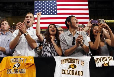 Students cheer as President Barack Obama speaks about the rising costs of student loans while at the University of Colorado at Boulder in Colorado, April 24, 2012. REUTERS/Larry Downing