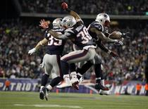 New England Patriots Danny Woodhead (L), Brandon Bolden (C) and Stevan Ridley celebrate after the Patriots scored a touchdown against the Houston Texans during the second half of their NFL football game in Foxborough, Massachusetts December 10, 2012. REUTERS/Jessica Rinaldi