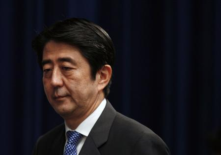 Then Japanese Prime Minister Shinzo Abe arrives at a news conference at his official residence in Tokyo, in this file picture taken September 12, 2007. A likely win by Shinzo Abe's Liberal Democrats in this weekend's election will give the ex-Japanese premier a second chance to achieve his goal of easing the limits of a pacifist constitution on the military to let Tokyo play a bigger global security role, Reuters reported on December 11, 2012. To match Analysis JAPAN-ELECTION/CONSTITUTION REUTERS/Toru Hanai