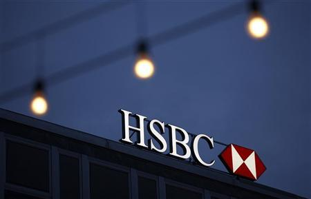 A HSBC logo is seen on the Private Bank Building in Geneva March 28, 2011. REUTERS/Denis Balibouse/Files