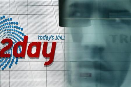 Advertisement is reflected at the entrance of the building that houses the 2Day FM radio station in Sydney December 8, 2012. REUTERS/Daniel Munoz