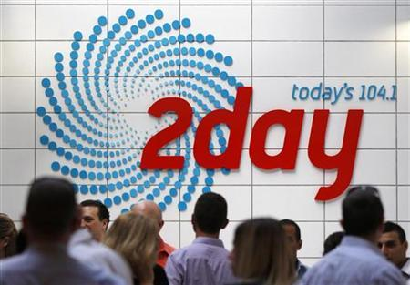 People gather in the foyer of the building that houses the 2Day FM radio station in Sydney December 6, 2012. REUTERS/Daniel Munoz
