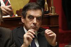 <p>François Fillon, engagé depuis trois semaines dans un bras de fer avec Jean-François Copé pour la présidence de l'UMP, s'est dit favorable mardi à l'organisation d'un nouveau vote ouvert à de nouvelles candidatures. /Photo prise le 4 décembre 2012/REUTERS/Charles Platiau</p>