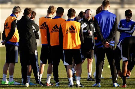 Chelsea's interim coach Rafael Benitez speaks to his players during a training session for the Club World Cup soccer tournament in Yokohama, south of Tokyo December 11, 2012. REUTERS/Yuriko Nakao