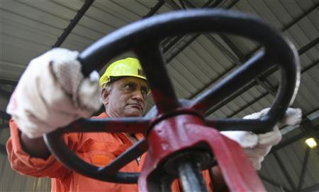 A technician opens the water valve of a pipe inside the Oil and Natural Gas Corp (ONGC) group gathering station on the outskirts of the western Indian city of Ahmedabad March 2, 2012. REUTERS/Amit Dave