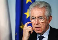 Italian Prime Minister Mario Monti gestures during a media conference at the Chigi palace in Rome December 6, 2012. The People of Freedom (PDL) party of Silvio Berlusconi said on Thursday that its walkout from a parliamentary confidence vote was a signal of its disapproval of Italy's economic policies and not an attempt to bring down the government of Monti. REUTERS/Stefano Rellandini (ITALY - Tags: POLITICS)