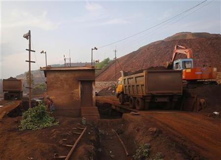 A truck is loaded with iron ore while being weighed at the Bedara Bhommanahalli (BBH) iron ore mines at Chitradurga in Karnataka November 9, 2012. REUTERS/Danish Siddiqui/Files