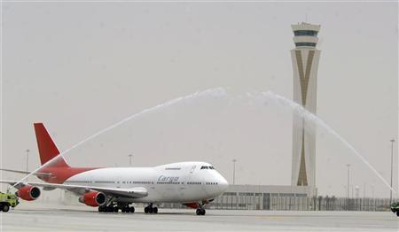 A welcome ceremony for a cargo airplane is conducted during the inauguration of the cargo terminal at Dubai's Al Maktoum International airport in this handout released on June 27, 2010. REUTERS/Dubai Airports/Handout