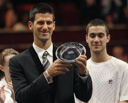 Serbian tennis player Novak Djokovic with the ''Centrepoint Premier Award for Contribution to the Lives of Youth Across the World'' in recognition of his Novak Djokovic Foundation at the Winter Whites Gala in aid of the homeless charity Centrepoint at the Royal Hall in London December 8, 2012. REUTERS/Luke MacGregor