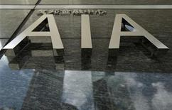 The logo of the AIA tower is seen at its entrance in Hong Kong July 13, 2010. REUTERS/Tyrone Siu (CHINA - Tags: BUSINESS)