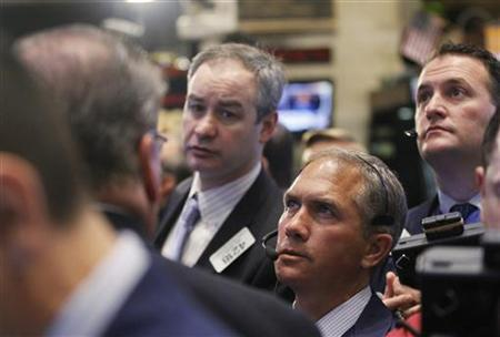 Traders work on the floor of the New York Stock Exchange, December 10, 2012. REUTERS/Brendan McDermid