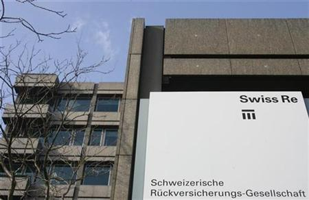 A logo is pictured in front of the headquarters of Swiss reinsurer Swiss Re in Zurich February 5, 2009. REUTERS/Christian Hartmann