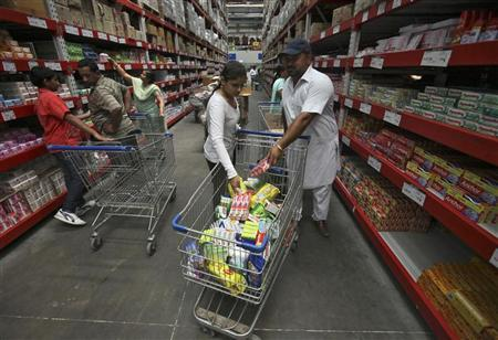 Customers shop at a Best Price Modern Wholesale store, a joint venture of Wal-Mart Stores Inc and Bharti Enterprises, in Zirakpur in Punjab June 8, 2012. REUTERS/Ajay Verma