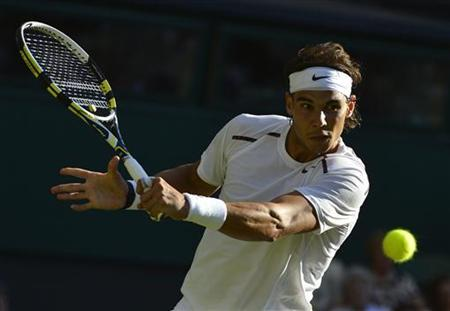 Rafael Nadal of Spain hits a return to Lukas Rosol of the Czech Republic during their men's singles tennis match at the Wimbledon tennis championships in London June 28, 2012. REUTERS/Toby Melville